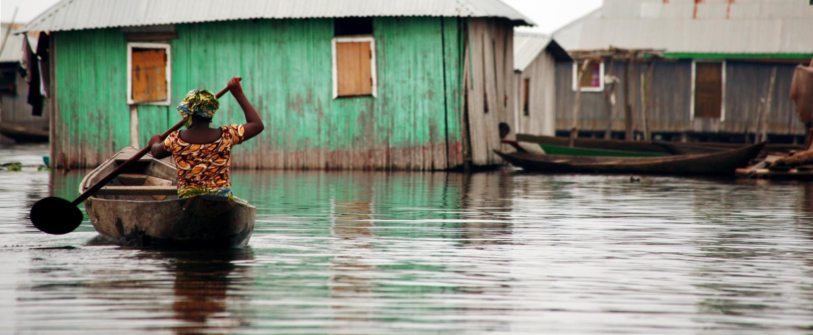 Local woman paddles through the water in Mozambique after Cyclone Idai struck the country in March